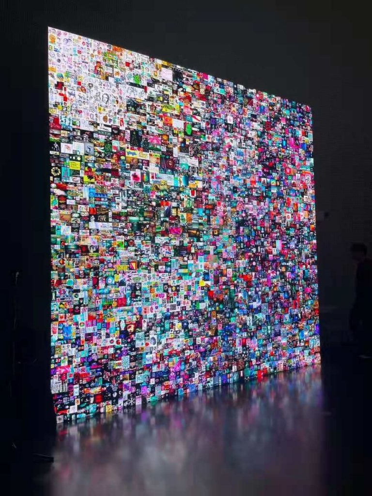 display of small artworks arranged in one large grid