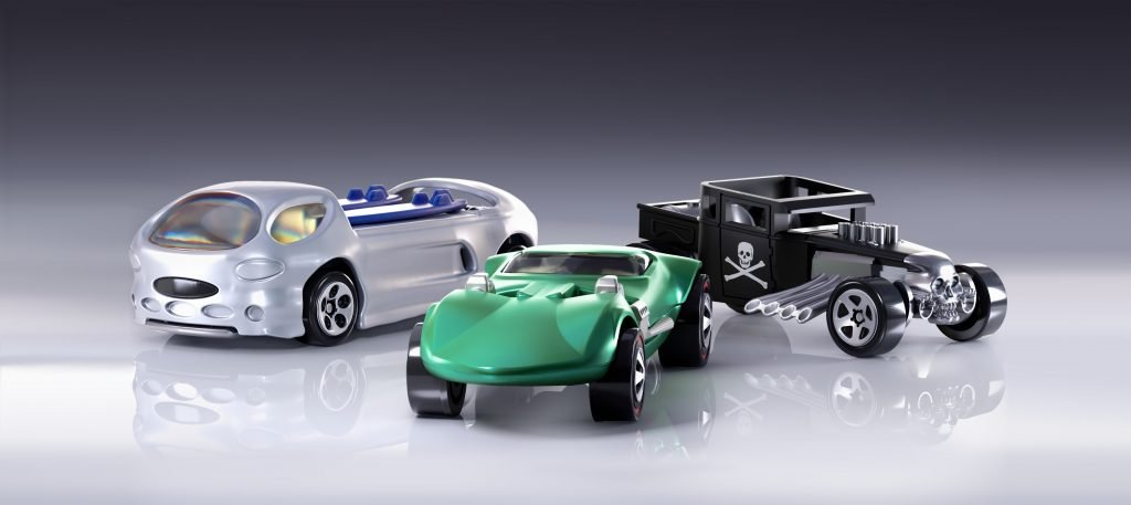 three hot wheels cars in formation