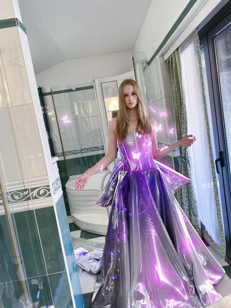 woman in long multicolored dress