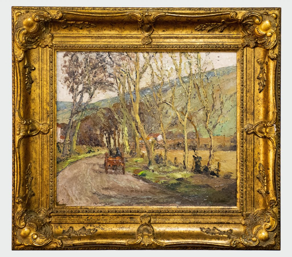 country lane with cart bordered by trees