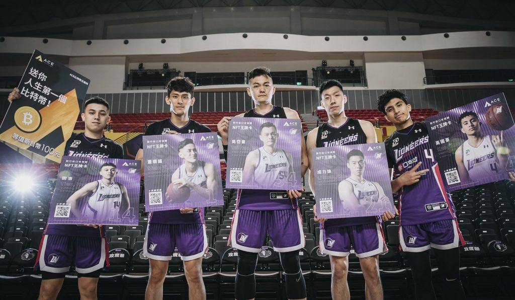 basketball players in a row showing posters of their NFTs